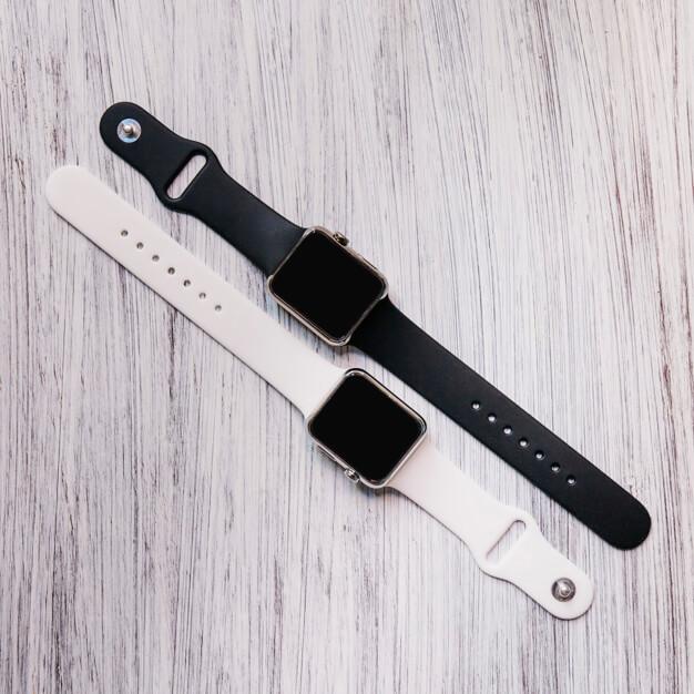 high angle view two black white smartwatch 23 2147797025 - ساعت هوشمند هوآوى بهتر است يا ساعت هوشمند شيائومى؟